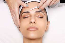 Woman getting dermaplaning to get prep her skin for spring
